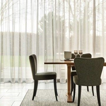 White Made to Measure Voile Curtains in a Dining Room Window - Serene Stone Voile Curtain