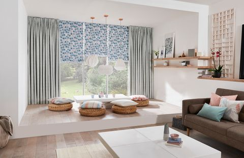 Open plan living room with pencil pleat curtains