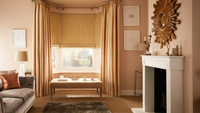 Clarence-Natural-Roman-blind-with-Erika-Champagne-curtains