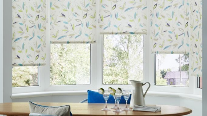 Joya Aqua Floral roller blind in a bay window