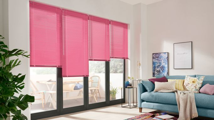 Fuchsia-Venetian-blind-in-living-room-bi-fold-doors