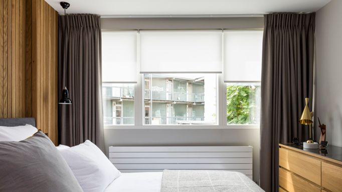 George Clarke Acacia Ice Motorised Roller blinds with Bardot Grey curtains