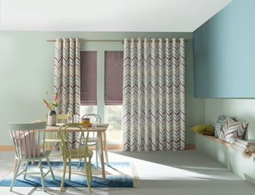 Made to Measure Souk Berry Haze curtains in a lounge setting