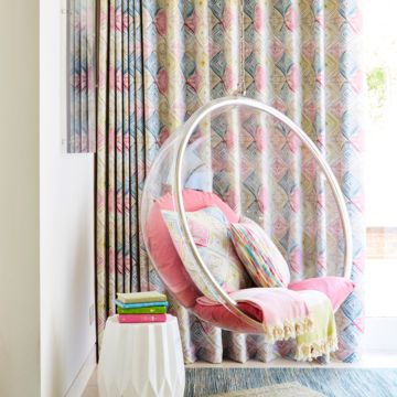 Lounge Room And Hanging Chair With Window Dressed Quadro Festival Curtains