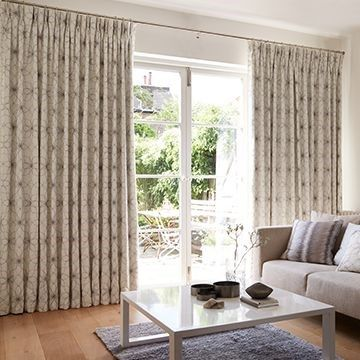 Living room setting with glass patio doors dressed with Lavida Grey Made to Measure Curtains