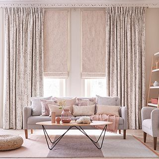 Luxury Living Room with Pink Pinch Pleat Curtains in Mirage Pumice paired with Mineral Linen roman blind
