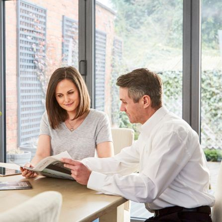 Advisor consulting with customer in a modern home