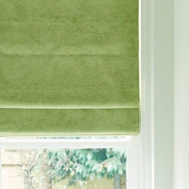 light green roman blinds close up