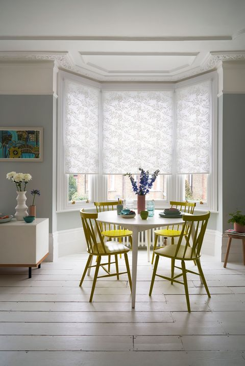 Leaf pattern Cecille White roller blinds hung in the dining room
