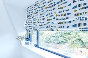 Bathroom with fish print roman blind