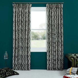 Abigail Ahern Cadillac Noir Curtains set against dark teal walls