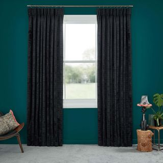 Abigail Ahern Cley Mole Curtains set against dark teal walls