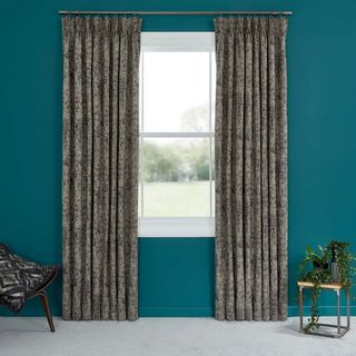 Abigail Ahern Garcia Phantom Curtains set against teal painted walls