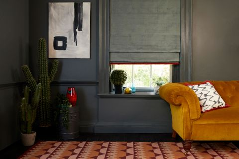 HIL_ABIGAILAHERN_LANDSCAPE_Cley-Donkey_Roman_blind_and_Wolfe-Smoulder_cushion_both_with_Colette-Vixen_fringing