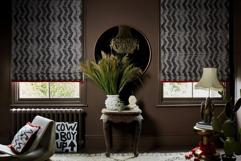 Cadillac Noir Roman blinds and cushions in Wolfe Smoulder with Colette Vixen fringing