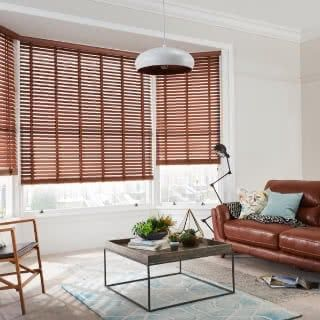 Living room with furniture and wooden blinds