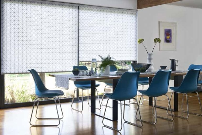 landscape roomset of roller blinds in dining room
