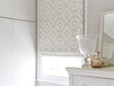 Closeup of a Mindoro Opal Roman blinds hanging in a classic bedroom