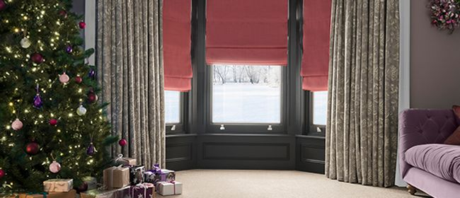 Christmas living room with Oralia Dove curtains and Clarence Petal roman blinds
