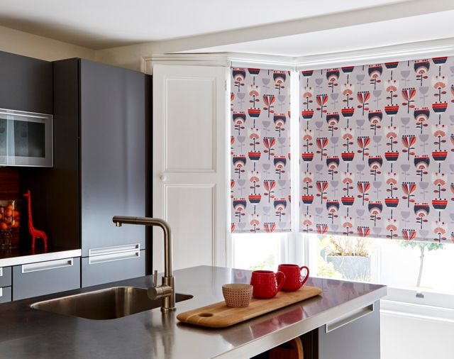 Imrie Scarlet Roller blind hung in warm family kitchen