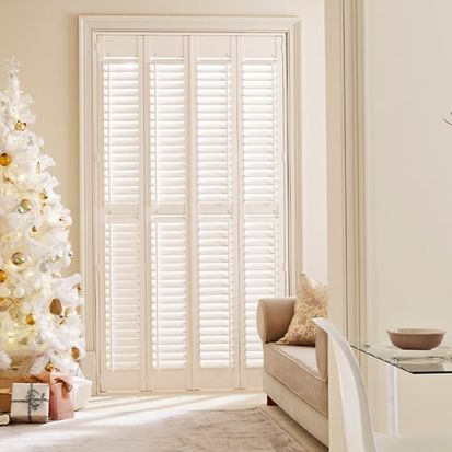 christmas dining room and lounge with henley pure white shutters on french doors