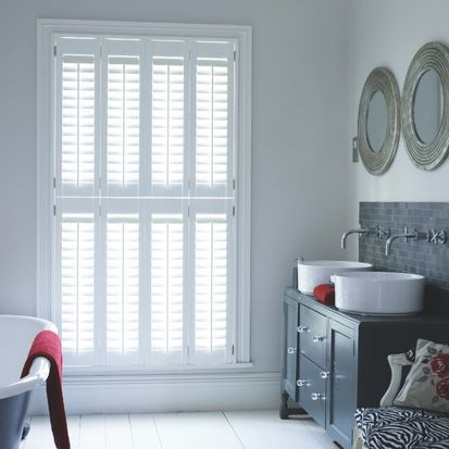 Bathroom with tier on tier bright white henley shutters