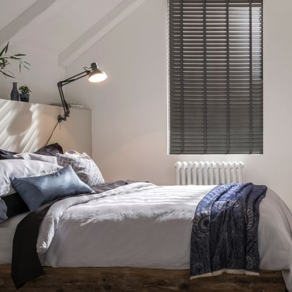 Loft bedroom with dark grey lunaire faux wood blinds