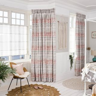 Bedroom with Fjord Coral curtains and Roman blinds in Ombre Natural