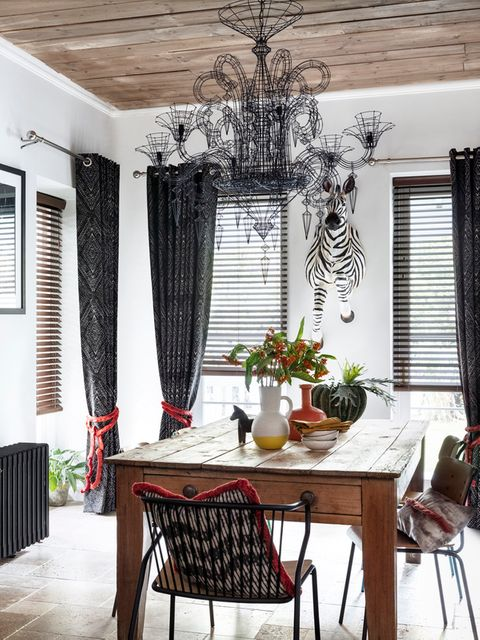 Burntwood Faux Wood blinds and Beats Haze curtains hung in a dining room