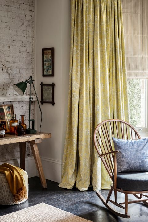 Howard Natural Roman blind with Oralia Ochre curtains in a rustic-style living room