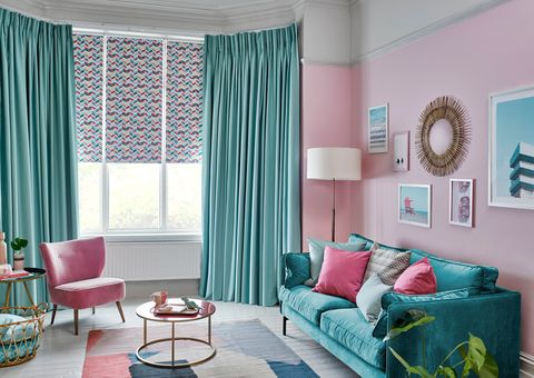 Jazz Fuchsia Roller blinds with Harlow Turquoise curtains hung in a kitschy 60s-inspired living room
