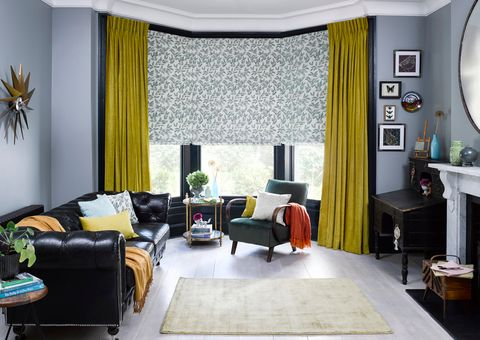 Delizia Teal Roman blind with Lyon Sulphur curtains in a living room