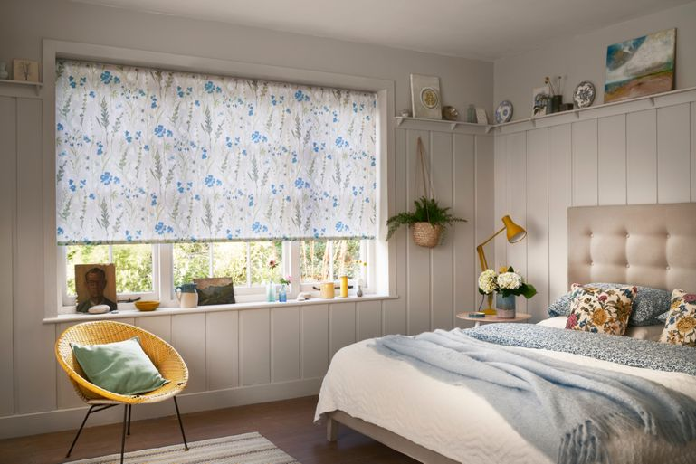 bedroom with blue penny ink roller blinds