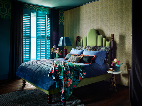Green custom colour shutters in a bedroom