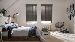 Bedroom with two windows fitted with Wooden blinds in Lunarre Faux Wood