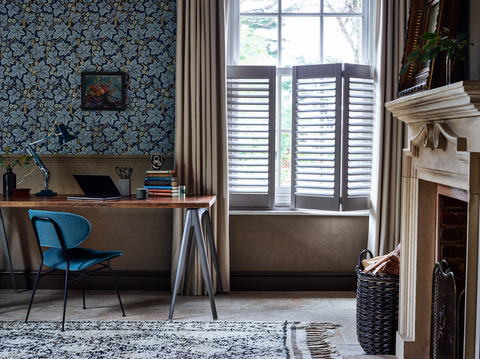 Home office with curtains layered over cafe style shutters