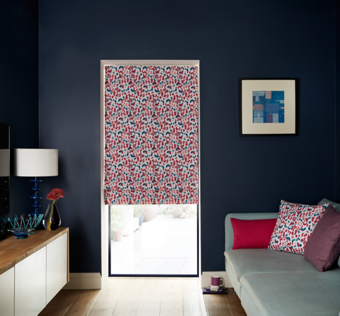Living room with small scale floral print Roman blind