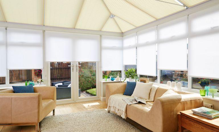 Salerno Sand Conservatory roof Roller blind and Malbec White Conservatory side Roller blind in conservatory