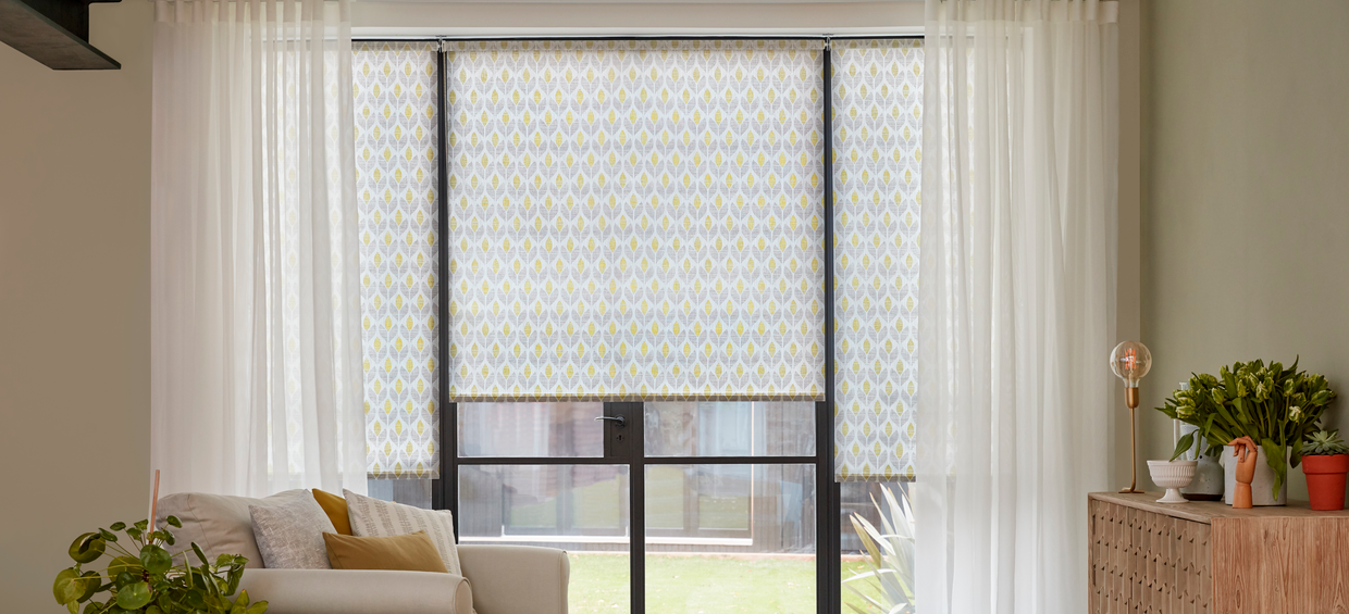 Crystal Ecru Voile curtains with Petula Olive Roller blinds in living room