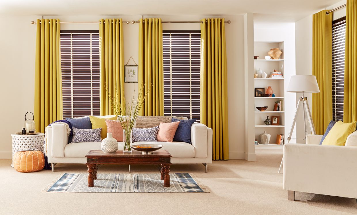 Hickory full length shutters with Tetbury Mustard curtains in living room
