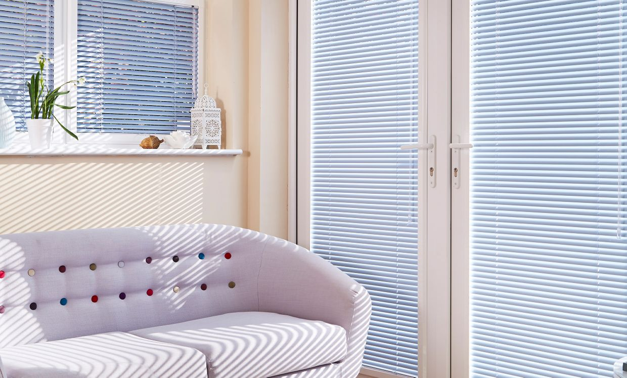 Oriental Blue Venetian blinds in conservatory