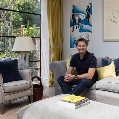 George Clarke in a living room