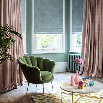 Romari Peach Curtains and Mineral Azure Roman blinds in living room