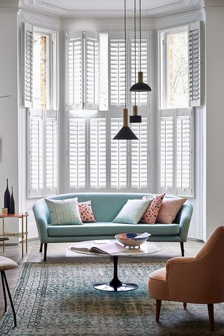 Tier-on-tier pure white shutters in living room
