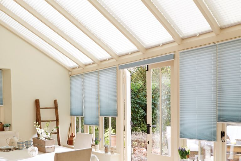 conservatory with grenoble cream pleated roof blinds