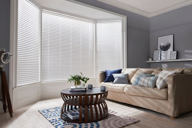 living room with fine white faux wooden blinds
