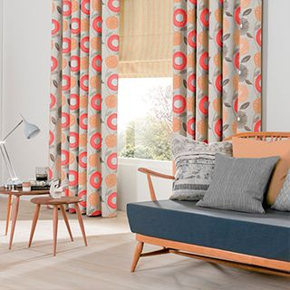 Freyja Coral Curtains in living room with wooden minimalist furniture
