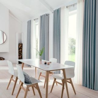 Horizon Denim Curtains floor to ceiling in dining room with white dining room furniture