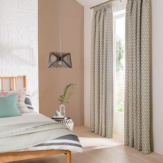 Laverne Glacier Curtains in bedroom with a bed and plant