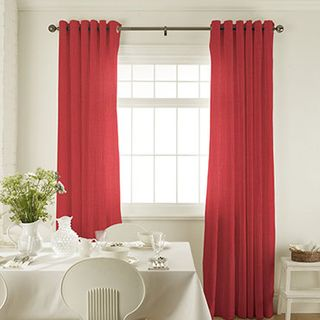 Tetbury Coral Curtains in dining room with white dining room furniture